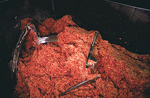 Ground beef in industrial grinder
