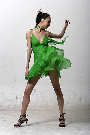 Asian model in green dress.