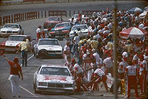 Bobby Allison pit crew works on his racecar in...