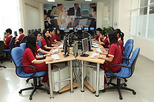 Students use computers at The Institute of Asi...