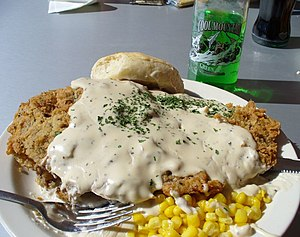 English: Chicken fried steak covered with grav...