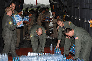 US Air Force personnel deliver relief supplies...
