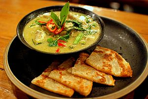 Green curry with chicken, served with roti