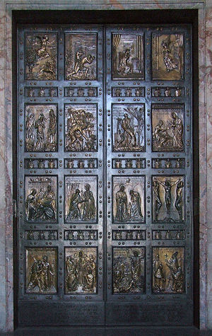 Holy Door in St. Peter's Basilica in Rome. Scu...