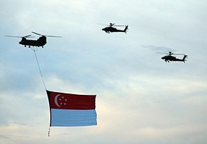 A giant Singapore national flag suspended from...