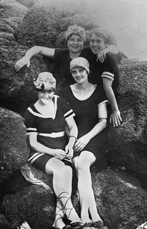 Group of women posing in their swimming costum...
