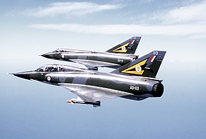 A left side view of a Mirage III D (top) and M...