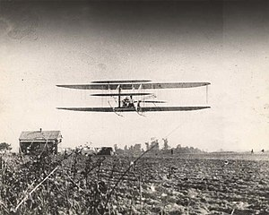 Wright brothers flying over the Kohn plantatio...