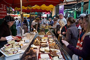English: A cake stall in busy Borough Market o...