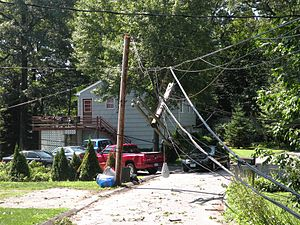 Damage to a power pole from a tornado in Shelt...