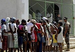 US Navy 100201-N-7653W-206 Haitian citizens qu...