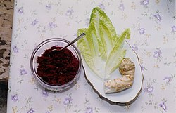 grated horseradish mixed with cooked beets and sugar (known as chrein in Yiddish); romaine lettuce; whole horseradish root