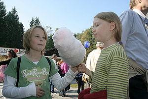 Girls enjoying cotton candy on a fair