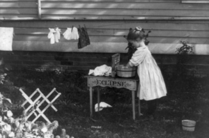 Little girl playing--doing laundry