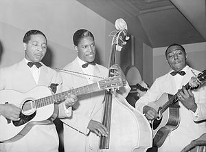 Lonnie Johnson and band playing in Chicago, 19...
