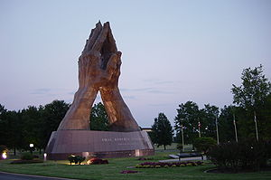 Photograph of the bronze sculpture Praying Han...