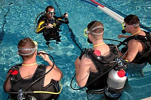 English: Wounded Warriors train in SCUBA at NM...