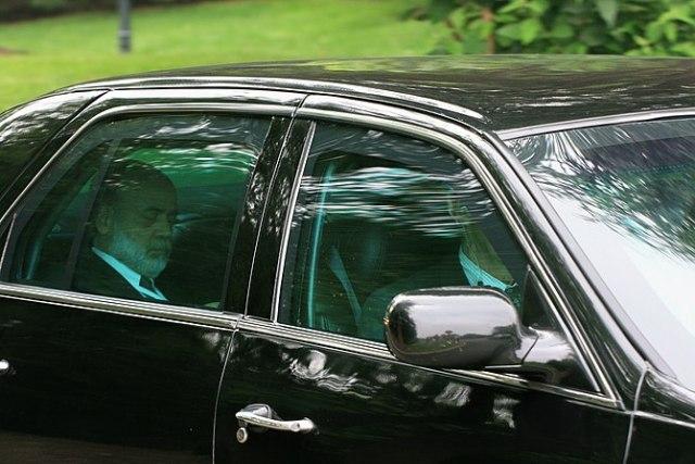 English: Ben Bernanke leaving the 2008 Bilderb...