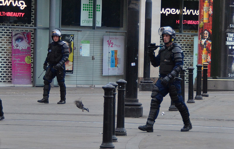 Riot police in Piccadilly Gardens