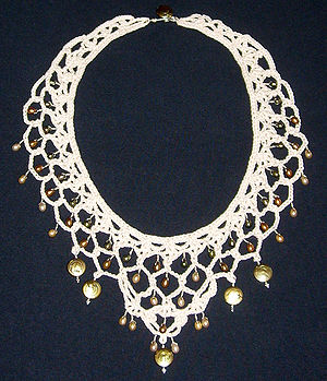 English: Necklace made from crochet lace, pear...