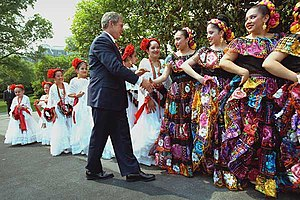 President George W. Bush greets dancers before...