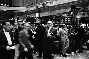 Photograph shows stock brokers working at the