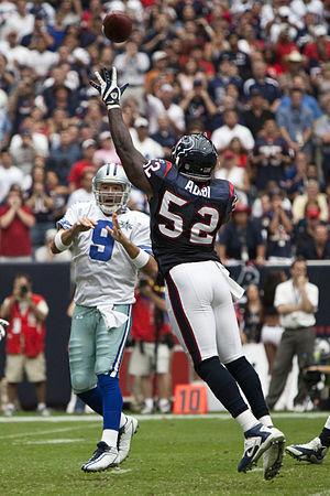 Tony Romo of the Dallas Cowboys gets a pass of...