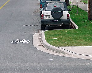 A bicycle symbol adjacent to a curb extension ...