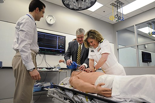 Flickr - Official U.S. Navy Imagery - ear Adm. Elizabeth Niemyer performs CPR on a medical dummy.