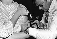 This 1976 photograph showed an adult receiving...