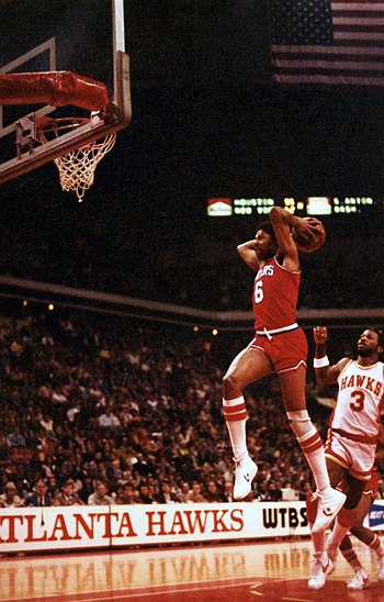 English: Julius Erving in 1981 performing a sl...