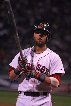 Dustin Pedroia of the Boston Red Sox on deck i...