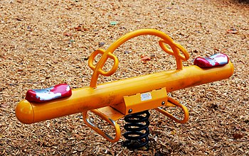 A seesaw or teeter-totter in a children's play...
