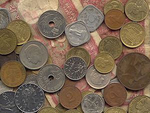 Assorted currency. Coins and notes