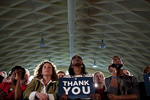"A member of the audience holds a ""Thank Y..."