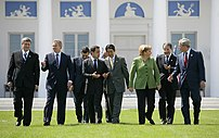 Leaders of the G8 walk across the grass en rou...
