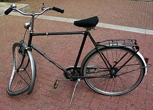 Bicycle with a torn front wheel after a crash ...