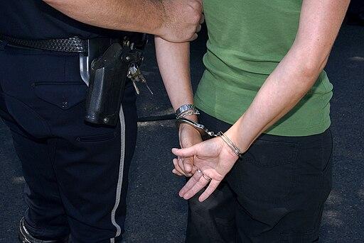 Demo arrest, handcuffed