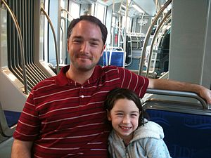 English: Father and Daughter ride The Tide Lig...
