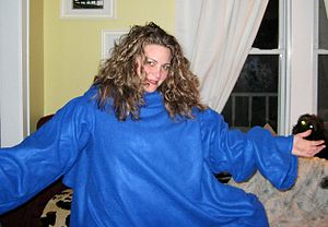 A woman models her Snuggie.