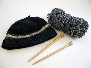 Description: Photo of knitted hat, yarn, and k...