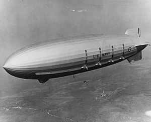 The U.S. Navy airship USS Macon (ZRS-5) conduc...