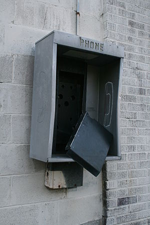 English: A broken pay phone in Durham, North C...