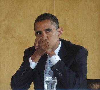 Obama listens to a question during a on Sand H...