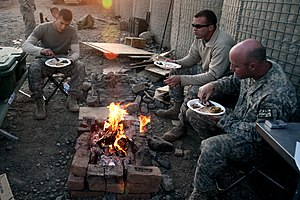 U.S. Army Soldiers eat their Thanksgiving meal...