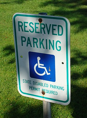 A sign indicating that the parking space requi...