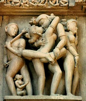 English: Sculpture from a temple at Khajuraho ...