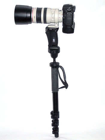 Camera and telephoto lens mounted on monopod