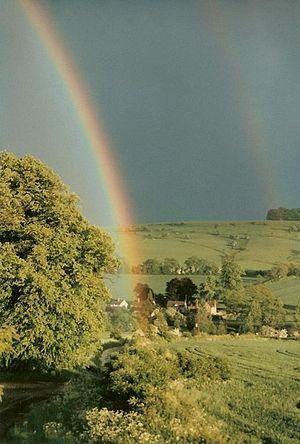 English: Rainbows over Colesbourne
