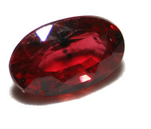 English: cut ruby gemstone with inclusions